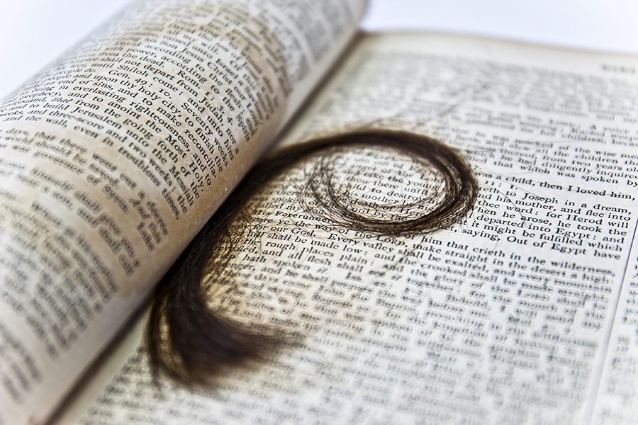 Bible with lock of hair inside.