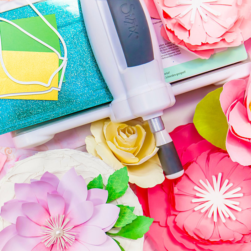 Learn how to make these gorgeous paper flowers!