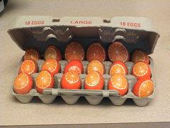 All my Orange Pysanky Eggs in one carton