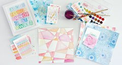 Julie Comstock had fun with the new Cosmo Cricket Watercolor Paper Collection