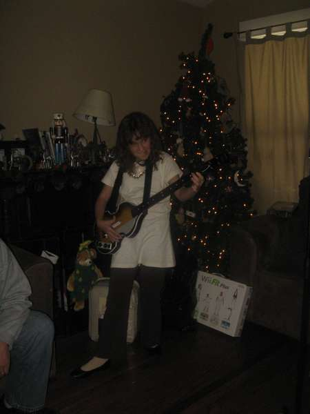 Daughter playing guitar