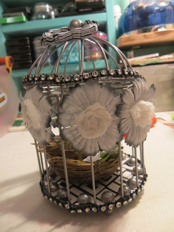 altered bird cage outside