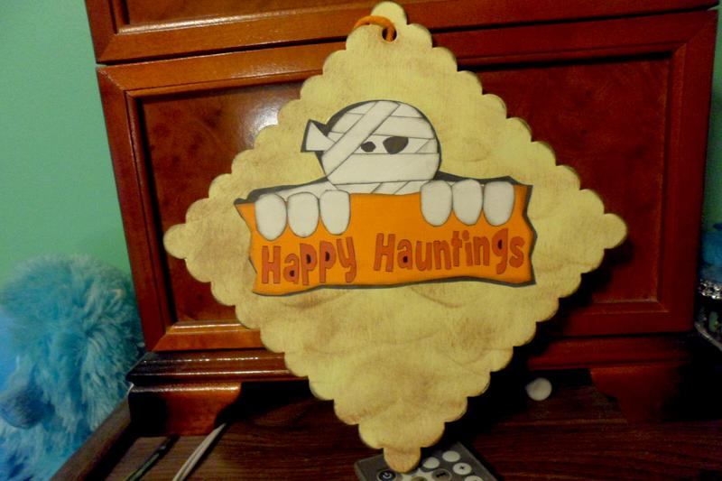 happy hauntings sign