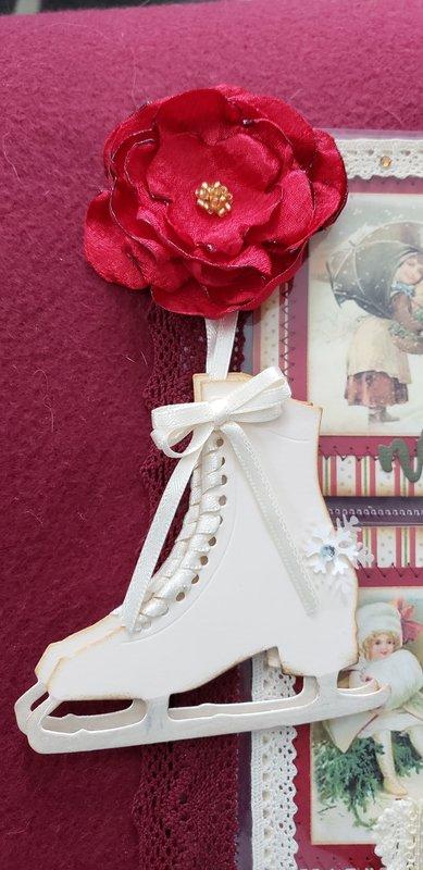 Red satin ribbon and skates