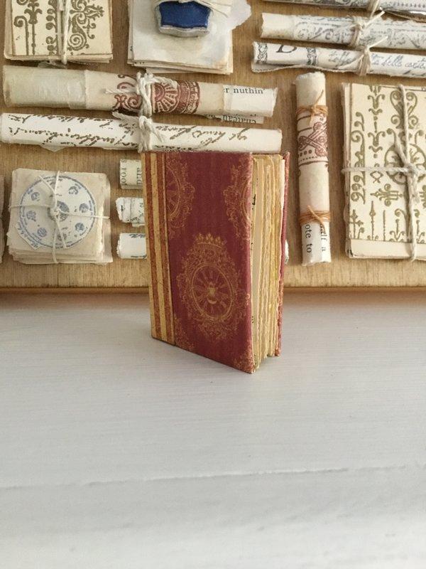 Tiny fake book inside altered tin