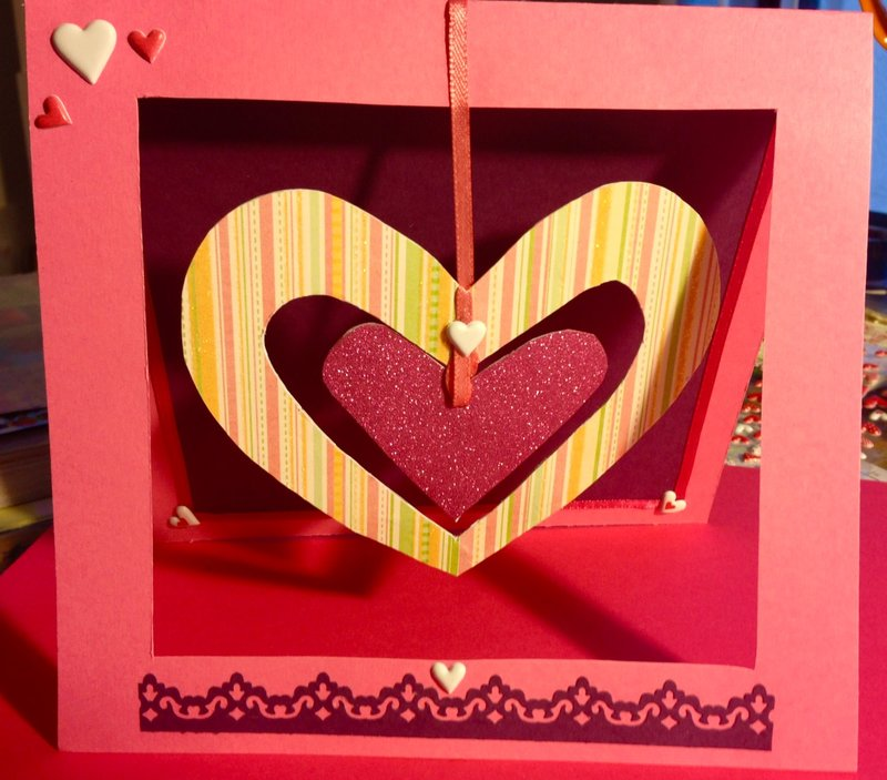 Valentine With Hanging Hearts in Window