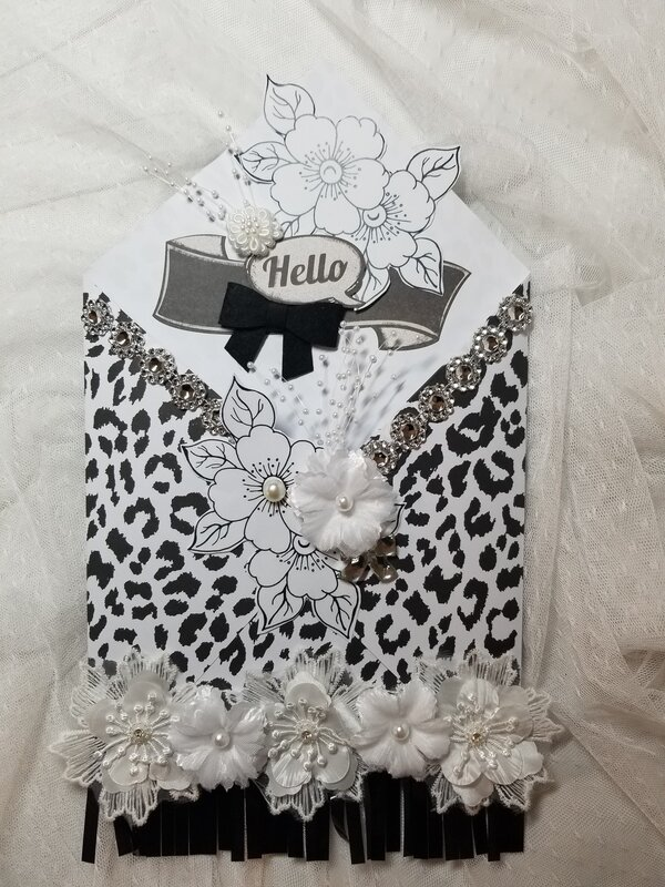 Black and white loaded envelope by Monique Nicole Fox