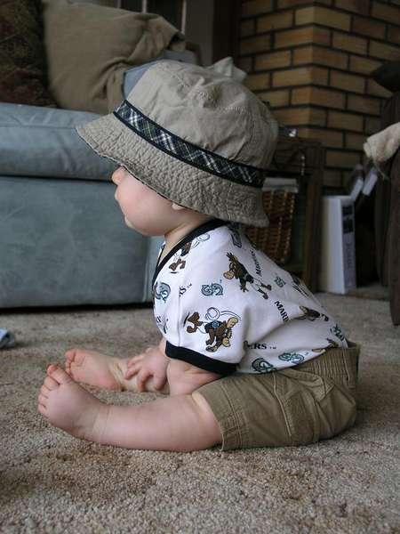 So cute in his sun hat