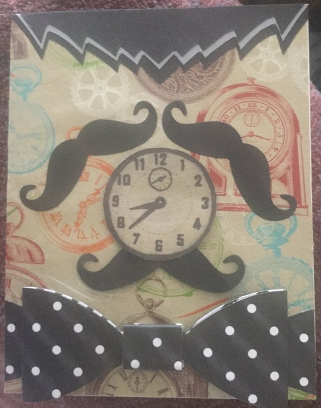 Do you see a clock or a man with a bow tie?