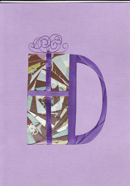 Iris folded letter D with gift