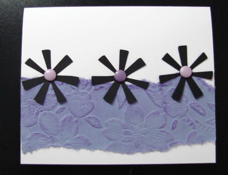 White card with black flowers and purple paper