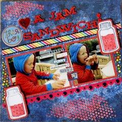 This boy loves a jam sandwich!