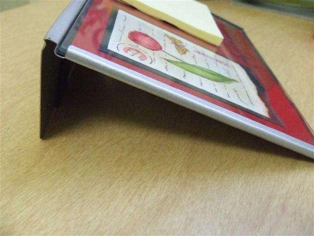 Altered photo frame / note holder