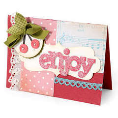 Enjoy by Debi AdamsCreate a card base out of cardstock. Layer patterned paper and decorative trim and sew in place. Die-cut Orna