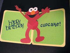 Elmo's Party Birthday Card inside.