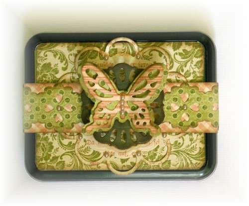 Altered gift tin **Spellbinders**