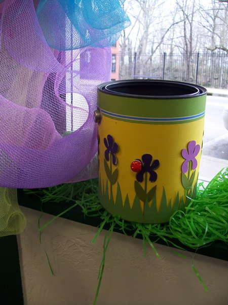 Garden-themed paint can