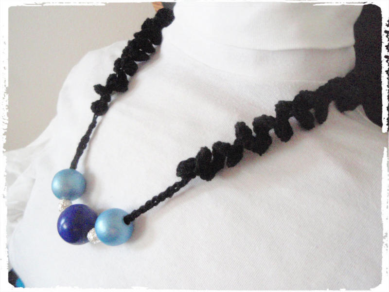 blue  necklace crocheted with twisted straps