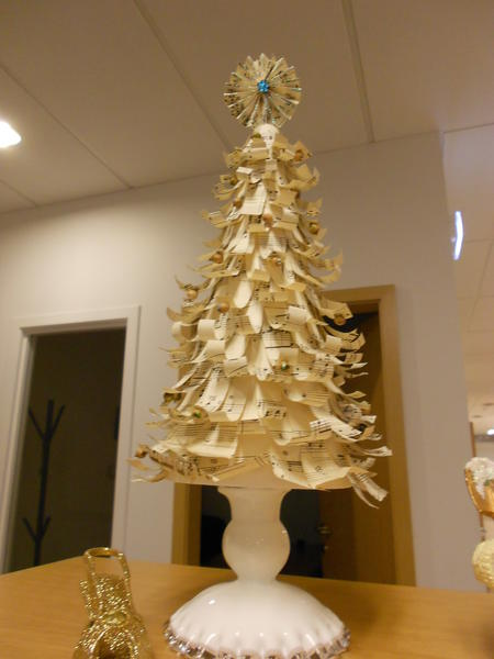 """Old music sheets Christmas tree."""