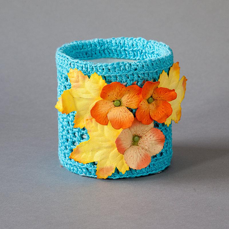 Turquoise tin with orange flower
