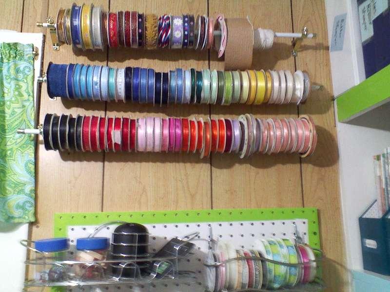 Ribbon storage on curtain rods.