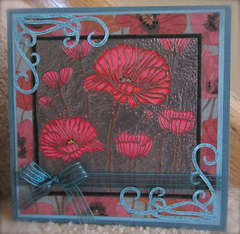 Red poppies on pewter with poppy paper