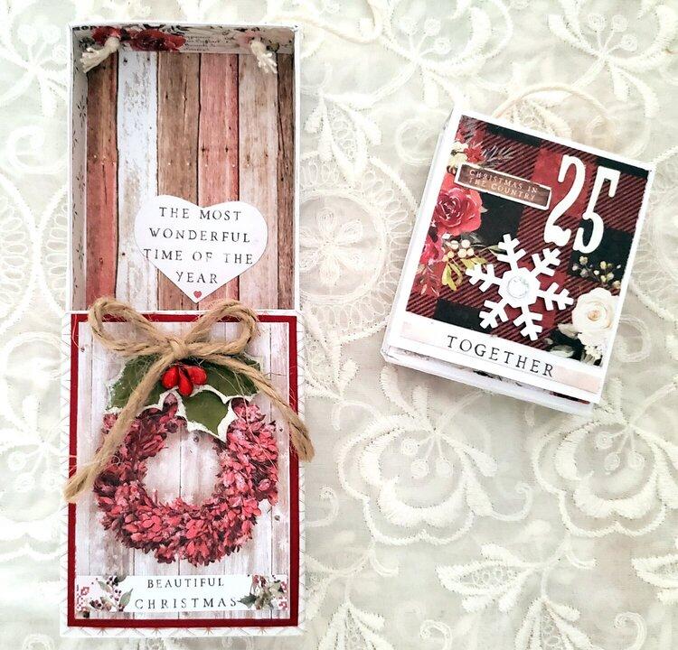 Match box ornament with tiny flip album inside