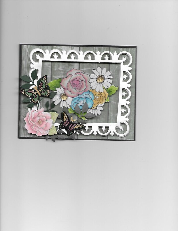 Framed Roses.  I saw a card on Scrapbook.com by Caletts and I though I would try doing a similar one myself.  Her card was so pr