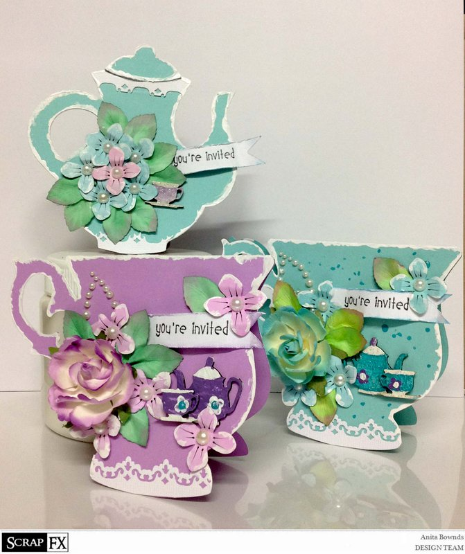 set of catds cups and teapot