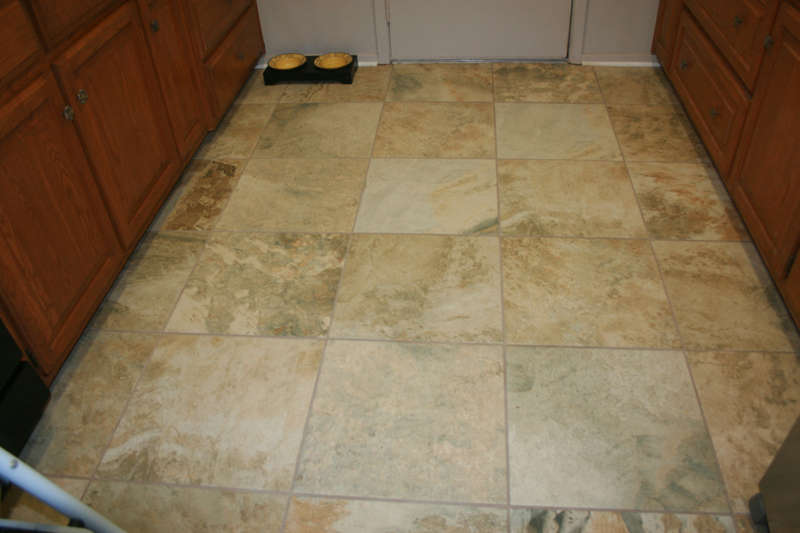 beautiful new tile in kitchen, hall & bathrooms.