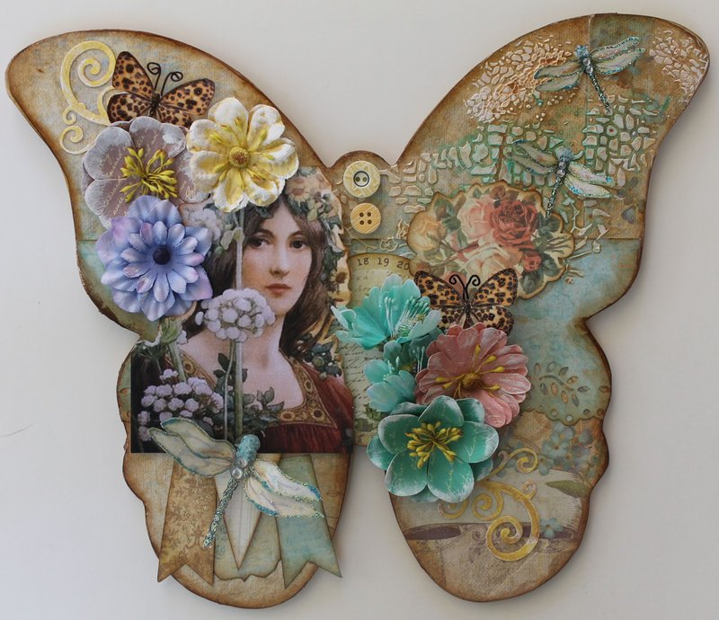 Altered wooden butterfly wall plaque