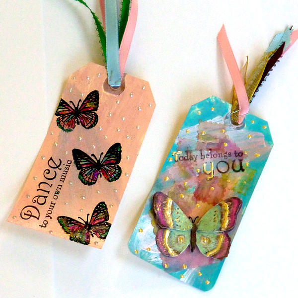 two mixed media tags