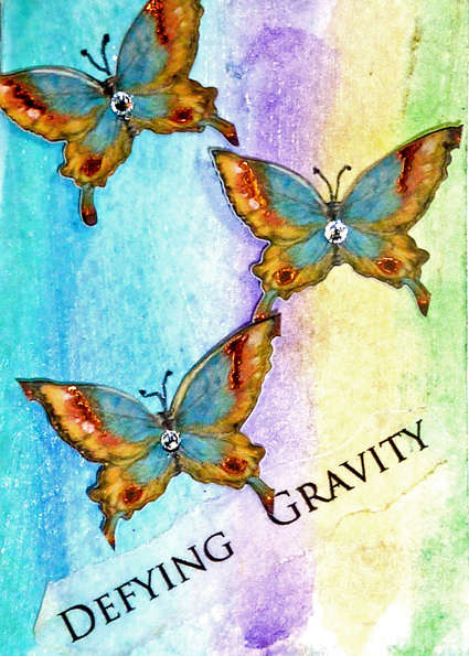 defying gravity mixed media collage art card