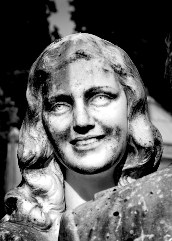 Face of a young woman  in San Miniato Cemetery in Florence Italy
