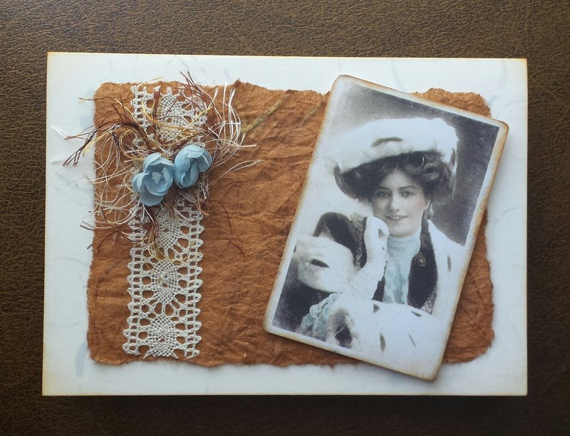 Vintage card oranged-colored brown with pale blue flowers