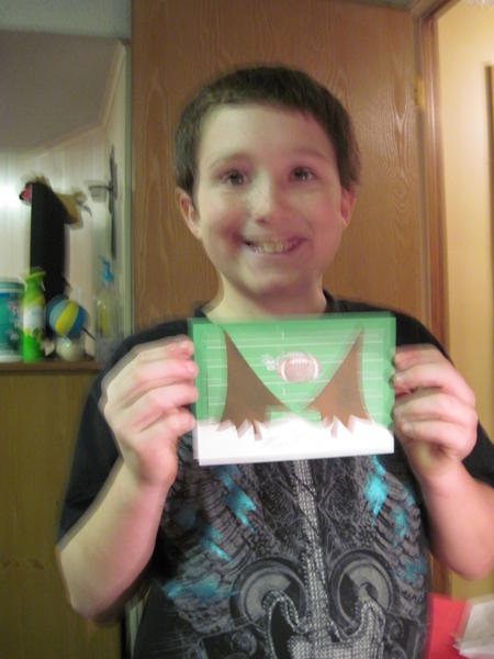 nephew with christmas card he designed with me.