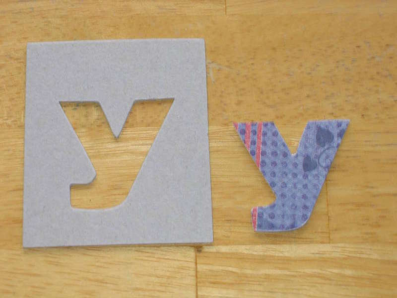 Altered chipboard letter