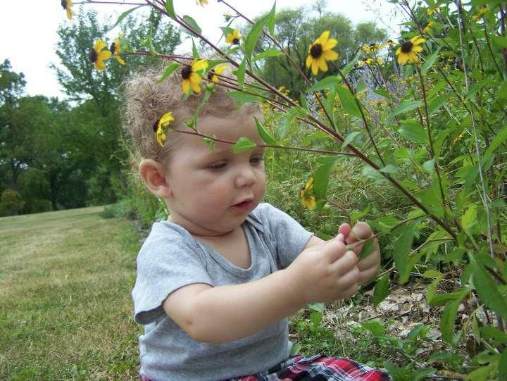 Baby in a Flower Garden