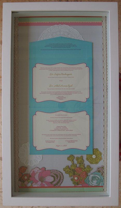 Wedding invitation in a frame