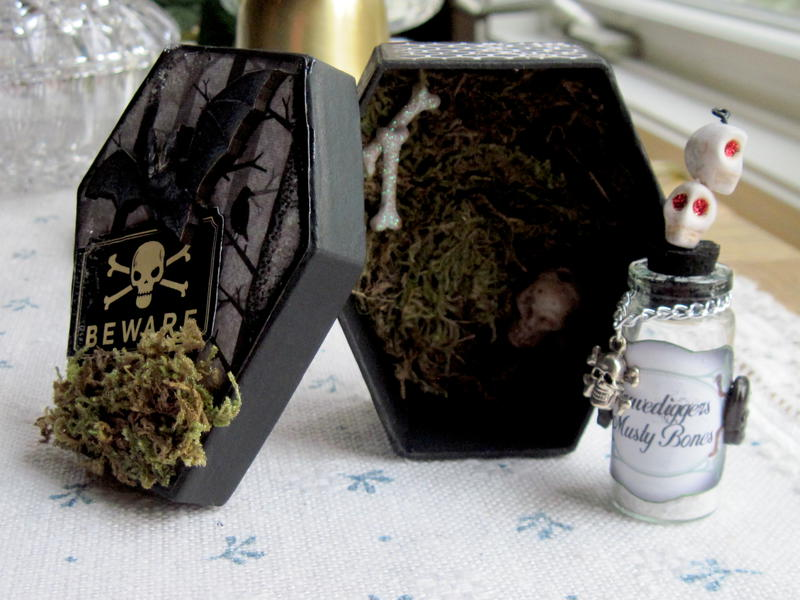 Coffin with apothecary jar