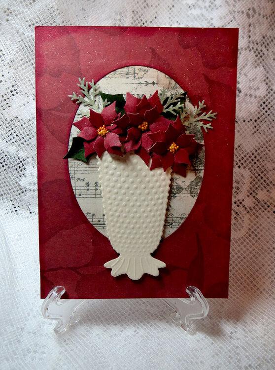 hob nail vase with poinsettias
