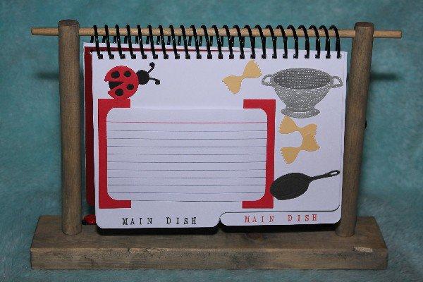 Lady Bug Cookbook on wood stand