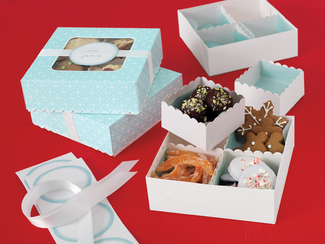 Just in time for the holidays - display your delectable cookies, whoopie pies, and baked goods in this grease resistant window box. White box is designed with red ribbon and holly sprig accent, featuring oval window - you're all ready to give that special treat!